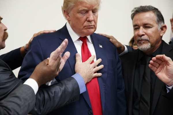 Image: Pastors from the Las Vegas area pray with Donald Trump