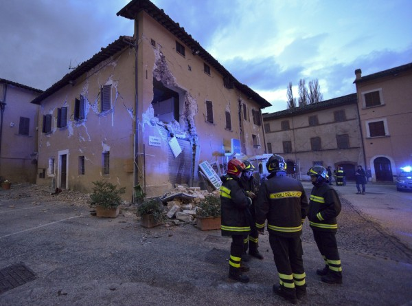 Image: Firefighters inspect the damage in Visso