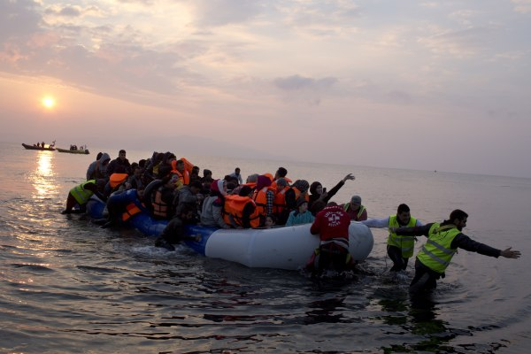 Image: Volunteers help migrants and refugees arriving on Lesbos