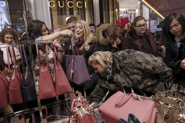 Women shop for handbags at Macy's Herald Square store during the early opening of the Black Friday sales in the Manhattan borough of New York
