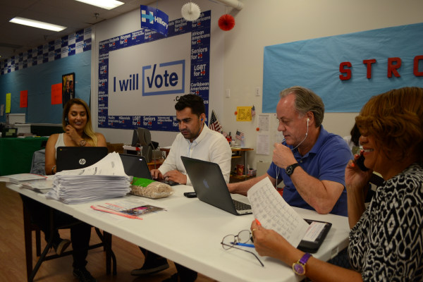 At a Clinton field office in Orlando, volunteers make calls urging voters to cast their ballots early.