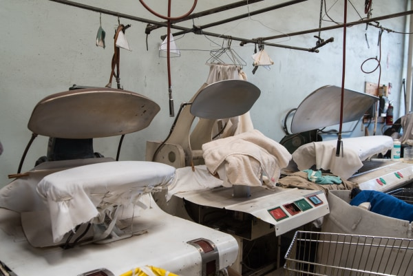Laundry pressing machines inside Ching Lee Laundry, which closed its doors after 140 years on October 29, 2016.