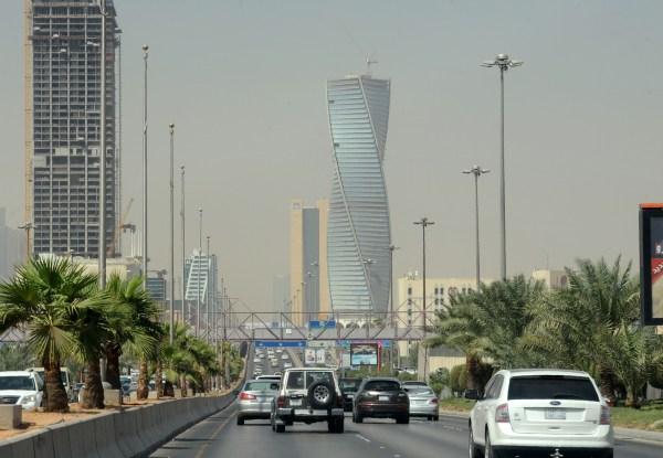 Image: Saudi commuters drive down a main street in the capital Riyadh