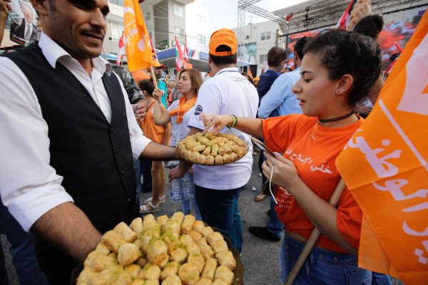 Image: Sweets are handed out in Batroun, Lebanon
