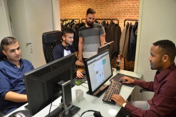 Taha, Jawad, Integrify CEO Rahman and Amin work at startup Integrify's office in Helsinki