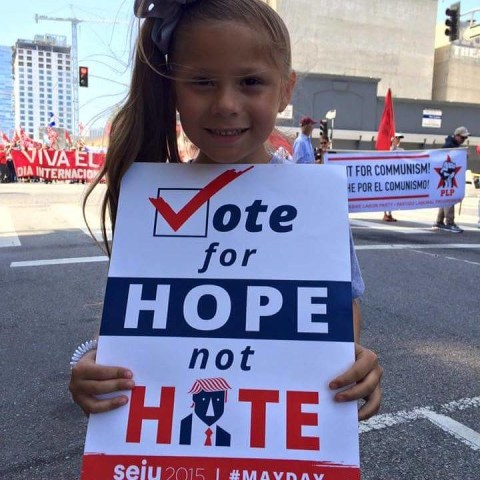 7-year-old Rosita Escobedo holds an anti-Donald Trump protest sign to combat bullying.