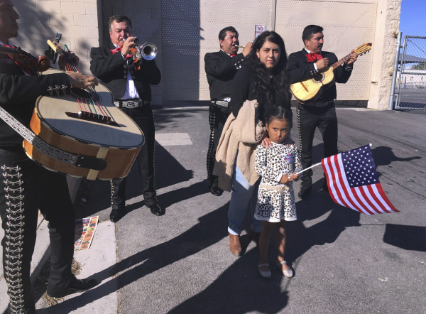 Image: A voter gets serenaded by a mariachi group
