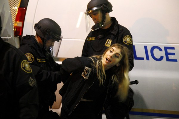Image: Police detain a demonstrator during a protest in Portland, Oregon