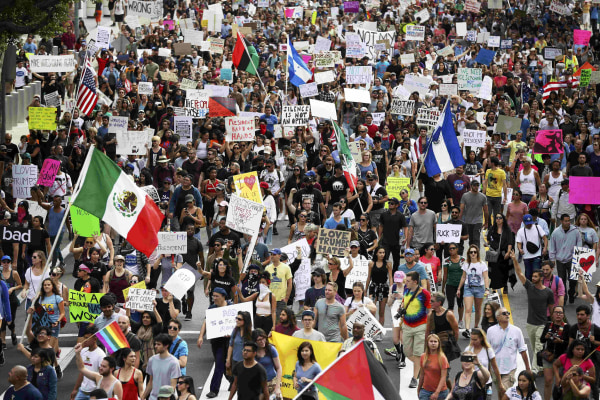Image: Protesters hold up signs during a march and rally against the election of Republican Donald Trump as President of the United States in Los Angeles
