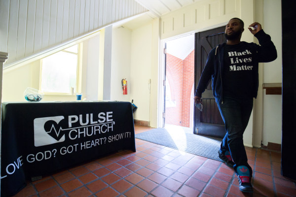 D'Andre Mayberry enters Pulse church before a church service