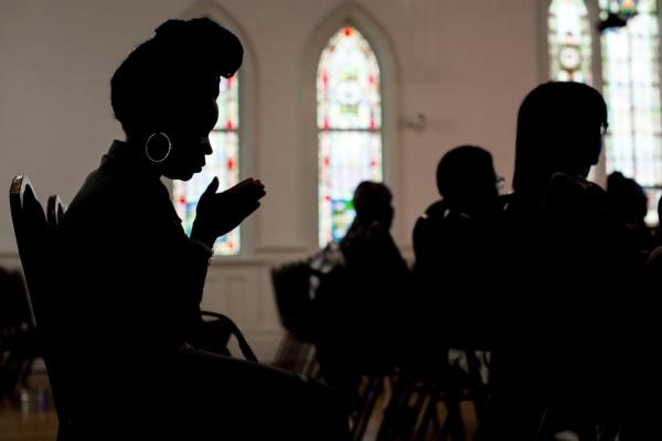 A woman prays during a church service at Pulse Church,