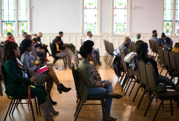 Congregants listen as pastor Billy Honor preaches during a church service at Pulse Church