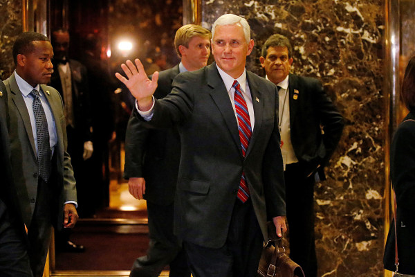 Image: Vice president-elect Mike Pence departs Donald Trump's Trump Tower in New York