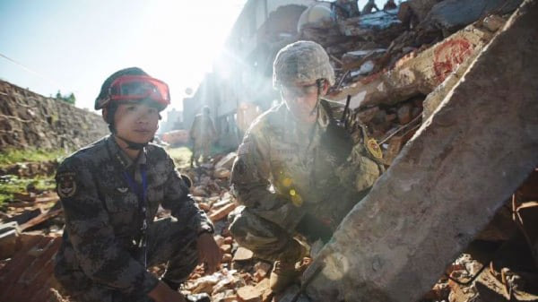 Image: A U.S. soldier and a member of the Chinese People's Liberation Army