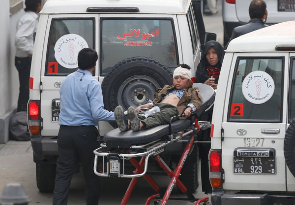 Image: An injured boy is transported to a hospital after a suicide attack in Kabul, Afghanistan