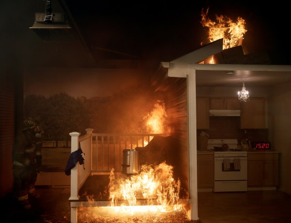 Image: Firefighter attempts to put out fire at a frozen turkey and deep fryer food safety demonstration in Rockville