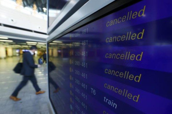 A passenger walks past a flight information board showing cancelled flights during a pilots strike of German airline Lufthansa at  Frankfurt airpor