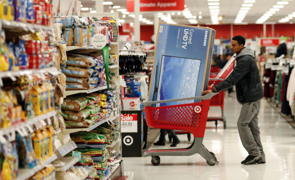 Image: Customer pushes his shopping cart during the Black Friday sales event on Thanksgiving Day at Target in Chicago