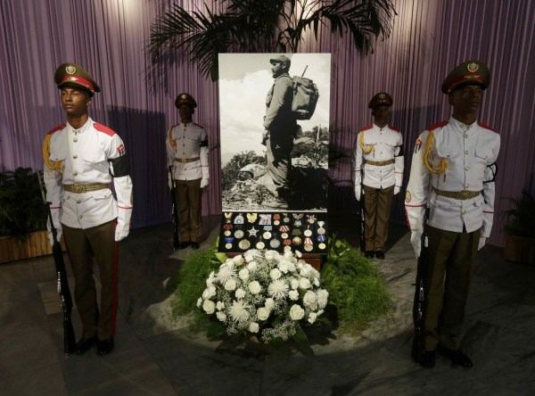 Image: A photograph of Cuba's late President Fidel Castro stands in tribute to him in Havana