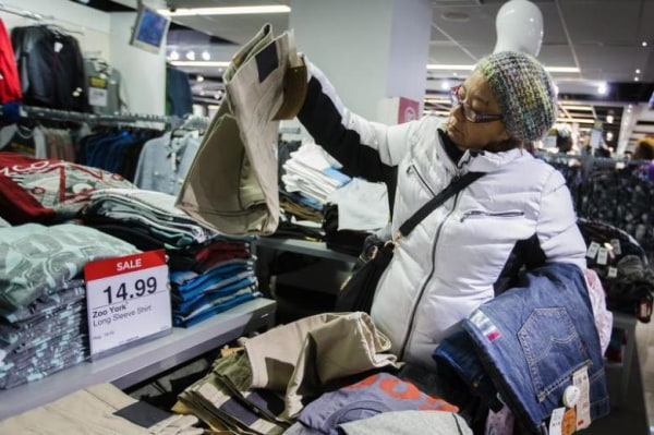 A shopper looks at items on sale inside of a JC Penney store during Black Friday sales in New York