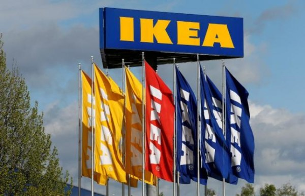 Flags and the company's logo are seen outside of an IKEA Group store in Spreitenbach
