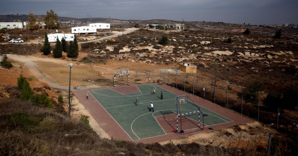 Image: A basketball court is seen in this general view of the Jewish settler outpost of Amona, in the West Bank