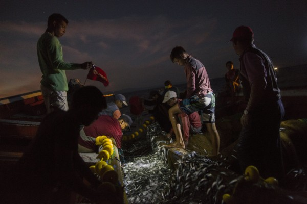 In this Oct. 31, 2016 photo, the Marval family fish at night in the sea, off Punta de Araya, Sucre state, Venezuela.