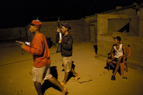 """Members of the Marval family, who patrol at night while other members of their family fish at sea, respond to what appeared to be the start of an attack by pirate gang leader """"El Beta"""" in Punta de Araya, Sucre state, Venezuela."""