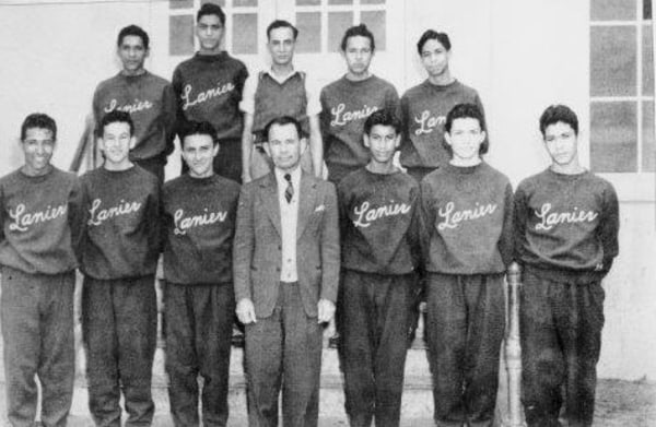 """The all-Mexican-American basketball team at Lanier High School in San Antonio, Texas with Coach William """"Nemo"""" Herrera in the center."""