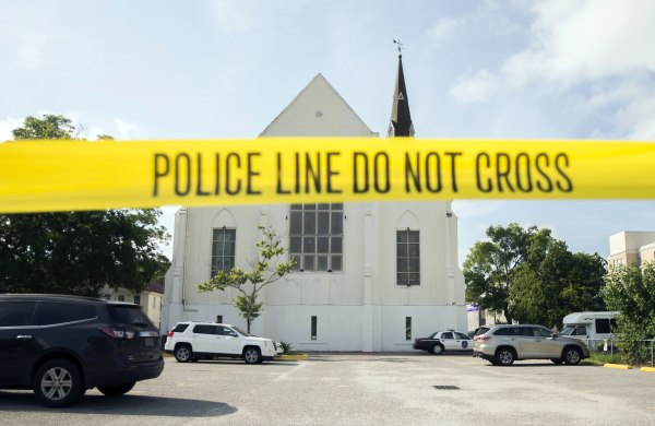 Image: Police tape surrounds the parking lot behind the AME Emanuel Church