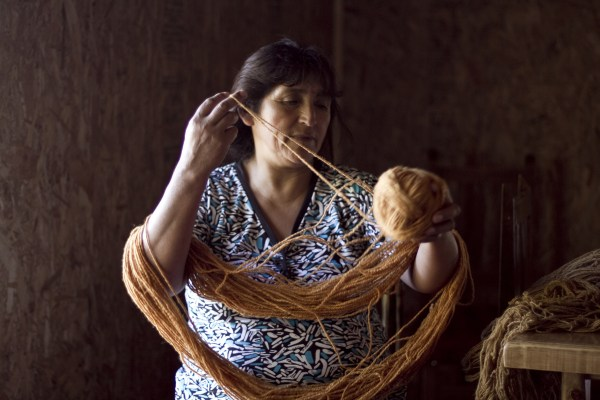 Oe of the Childean weavers with VOZ, the ethical fashion luxury brand working with indigenous South American artisans.