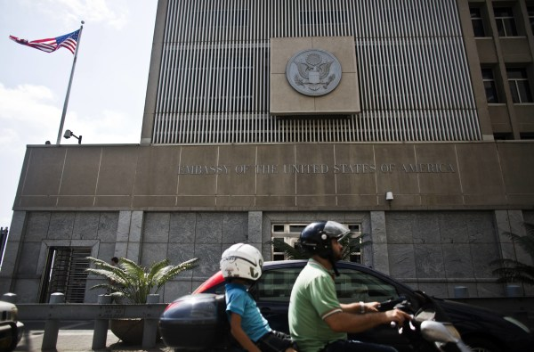 Image: Motorists drive past the U.S. Embassy in Tel Aviv in August 2013