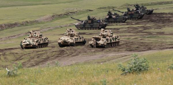 Image: U.S. Bradley infantry fighting vehicles and M1A2 Abrams tanks