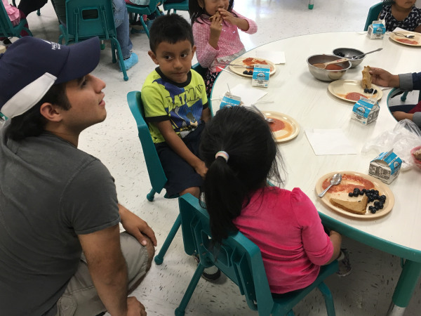 Misael Rangel with toddler at the Parksley Center on the Virginia Eastern Shore , part of the East Coast Migrant Head Start Project.