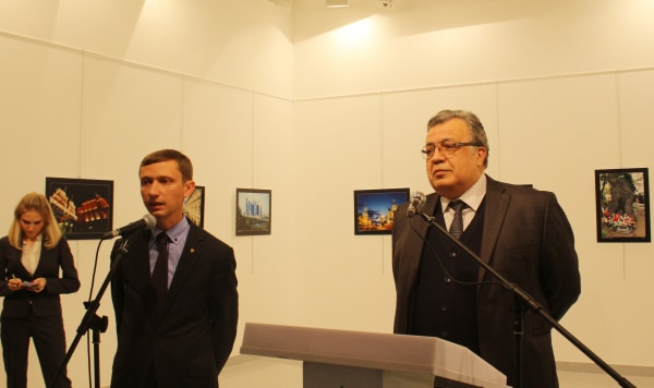 Image: Russian Ambassador to Turkey, Andrei Karlov (R) gives a speech