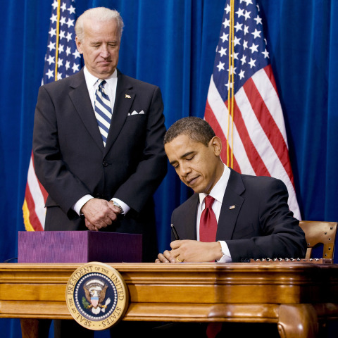 Image: U.S. President Barack Obama signs stimulus package bill at the Denver Museum of Nature and Science