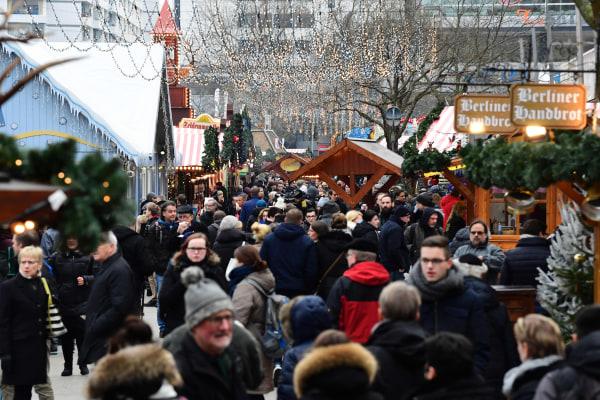 Image: People walk between booths at the Christmas market near the Kaiser-Wilhelm-Gedaechtniskirche (Kaiser Wilhelm Memorial Church) in Berlin on Dec. 22, 2016.