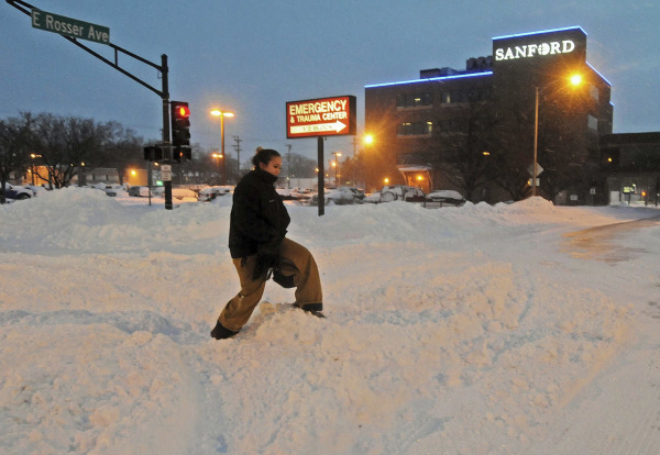 Image: A woman makes her way through snow