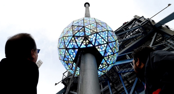 Image: Workers test out the lighting on the New Year's Eve ball