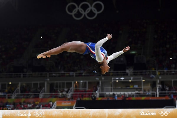 Image: Simone Biles competes in the beam event of the women's individual all-around final