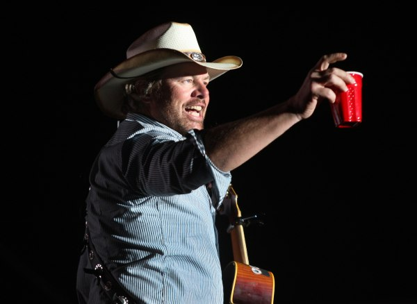 Toby Keith toasts his fans with a red solo cup, the name of one of his hit songs on the Mane Stage