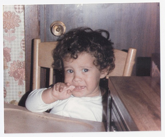 Venezuelan activist Francisco Marquez, as a toddler, sucks on his finger while sitting in his high chair in Caracas, Venezuela in 1988.