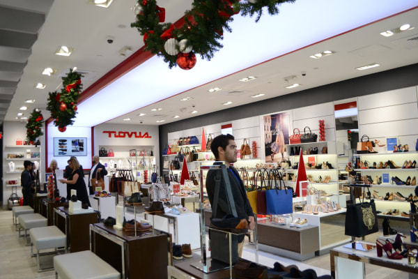Employee working in the Puerto Rican shoe store Novus during the Holiday season in Pembroke Lakes Mall in Pembroke Pines, Florida.