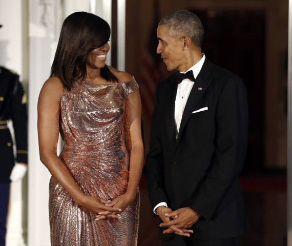 Image: President Barack Obama and first lady Michelle Obama wait to greet Italian Prime Minister Matteo Renzi and his wife Agnese Landini on the North Portico for a State Dinner at the White House in Washington, D.C., Oct. 18, 2016.