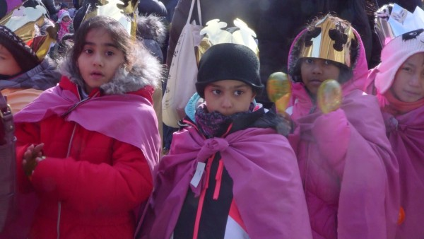 Children from P.S. 103 in the Bronx, New York City, walk in the 40th annual Three Kings Day Parade organized by El Museo del Barrio.