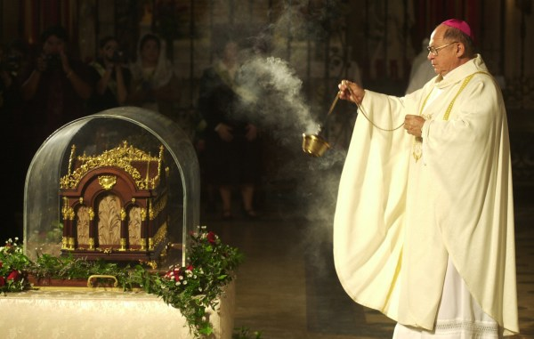 Image: Archbishop Patrick Flores incenses the reliquary of St. Therese on Dec. 3, 1999 at the Basilica of the Nation Shrine of the Little Flower in San Antonio, Texas.