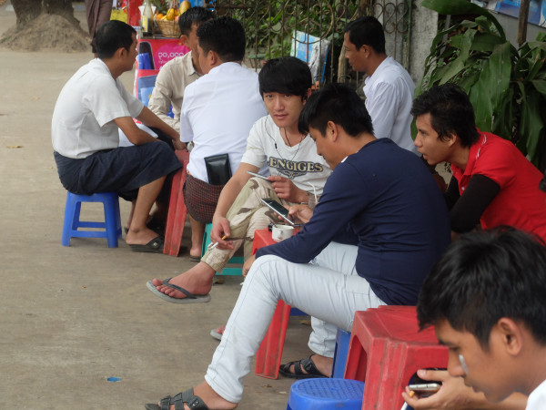 Image: Men at a roadside tea stall in Yangon
