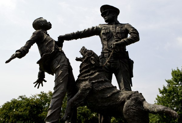 Image: A young protester confronted by a police officer and a snarling police dog is depicted in a sculpture in Kelly Ingram Park in Birmingham, Ala. on Aug. 6, 2013.