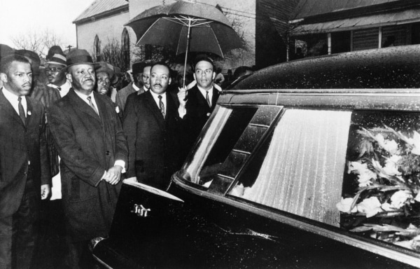 Image: Dr. Martin Luther King, Jr. and associates lead a procession following the casket of Jimmy Lee Jackson during a funeral service in Marion, Alabama, March 1, 1965.