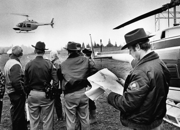 Image: In this undated file photo, a helicopter takes off from search headquarters to scour the area where hijacker Dan Cooper might have parachuted into in Woodland, Wash.